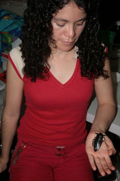 Elisa Cabrera-Guzmán with a giant waterbug.